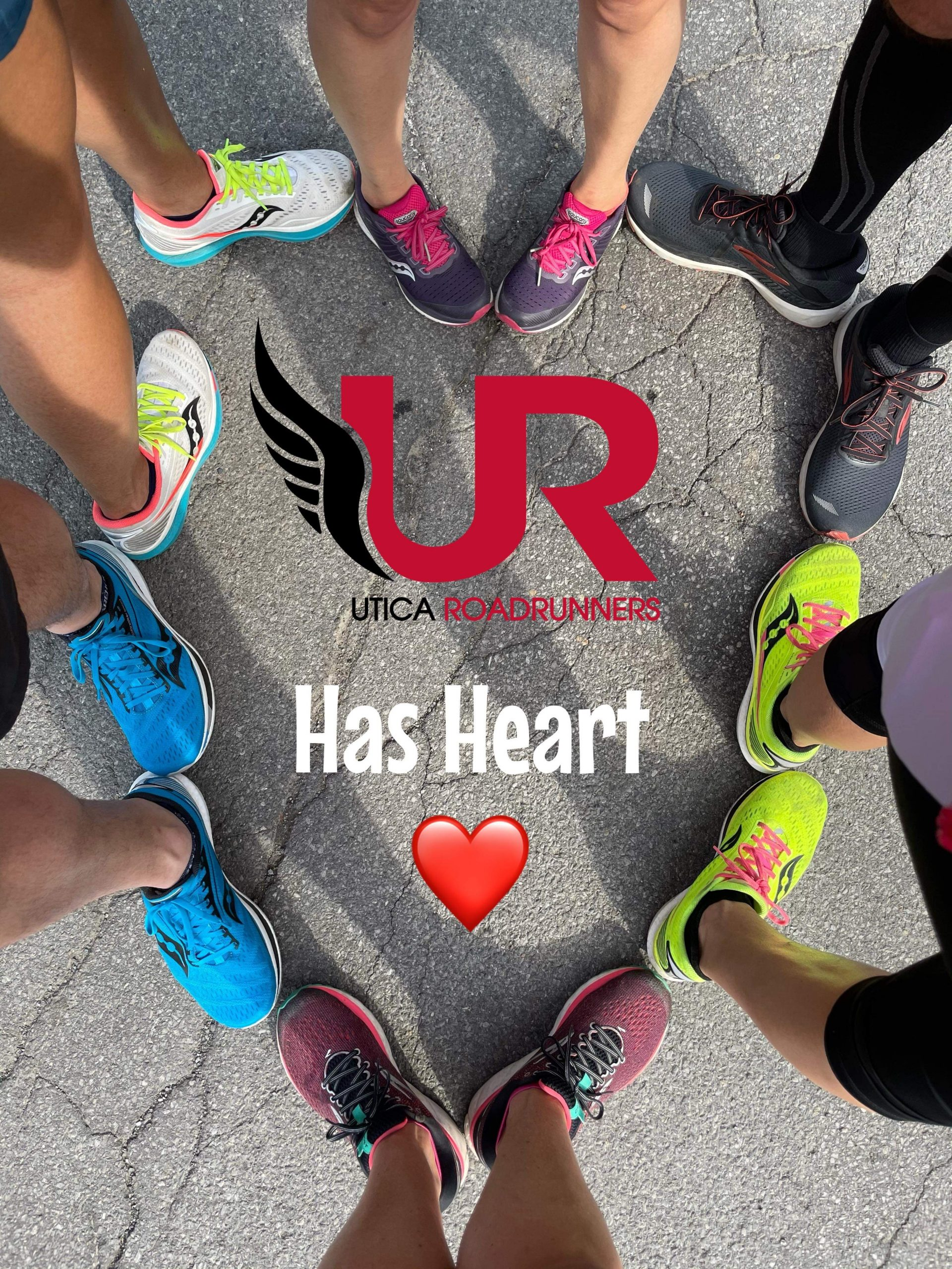 Running shoes lined up in a heart shape
